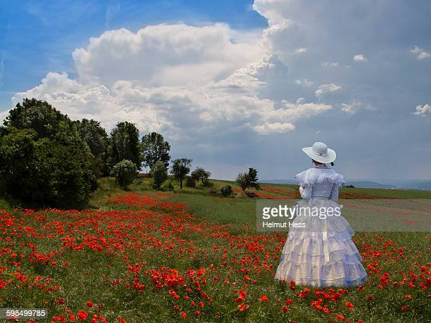 Woman on a meadow with poppies