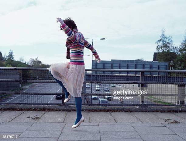 Woman on a motorway bridge