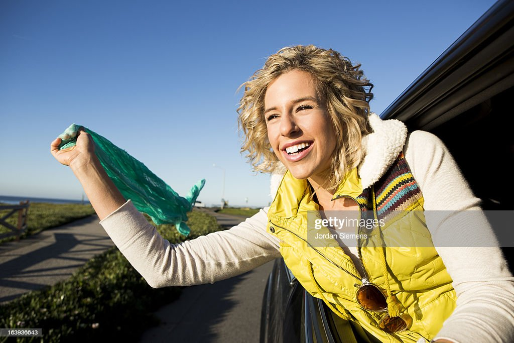 A woman on a road trip. : Stock Photo