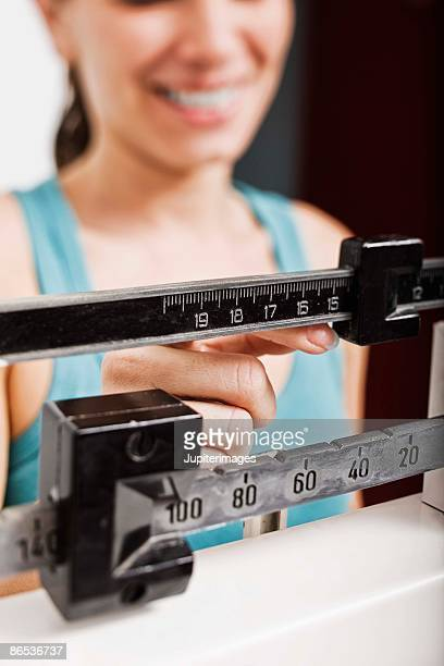 Woman on a scale checking weight