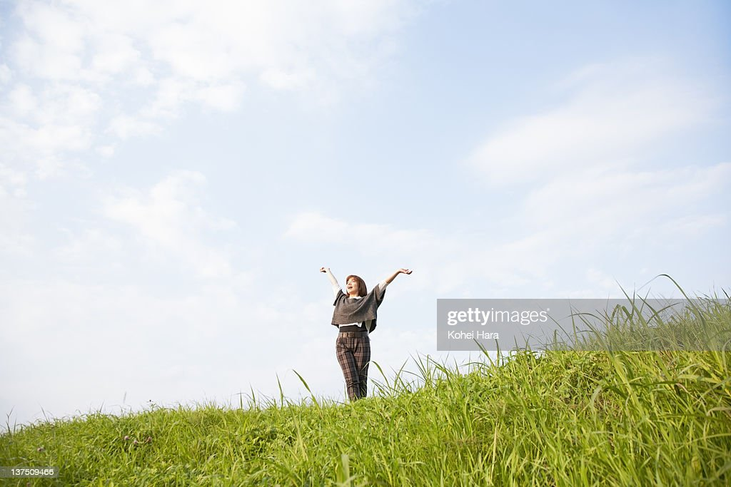 woman on a small hill : Stock Photo