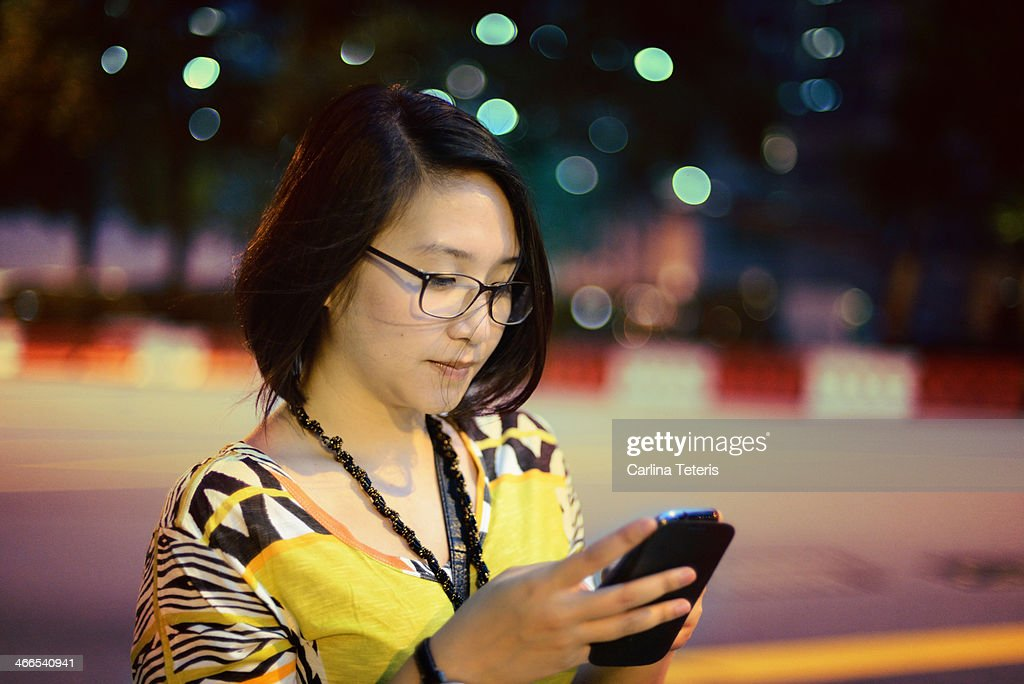 Woman on a smart phone in the night