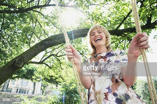 Woman on a Swing : Foto stock