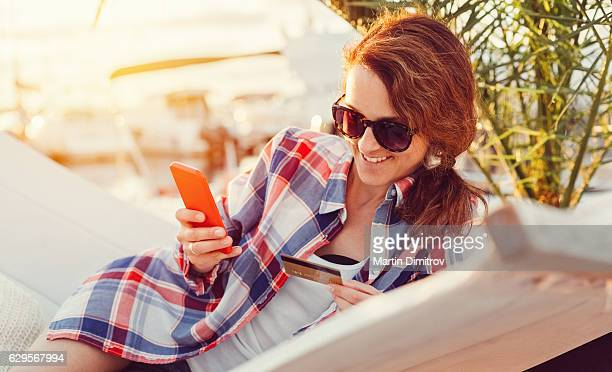 Woman on a vacation shopping online