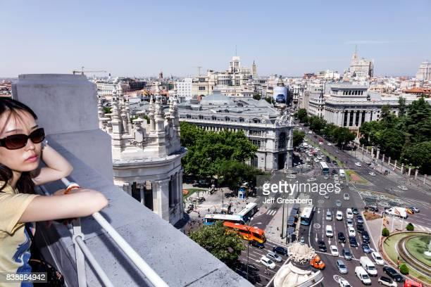 A woman on an open air balcony at Terrazamirador del Palacio de Cibeles