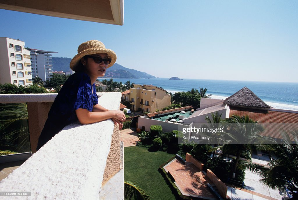 Woman on balcony overlooking ocean ixtapa mexico stock for Balcony overlooking ocean