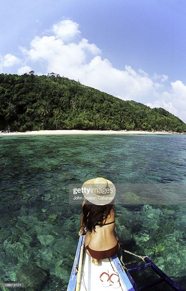 Woman on banca boat. : Stock Photo
