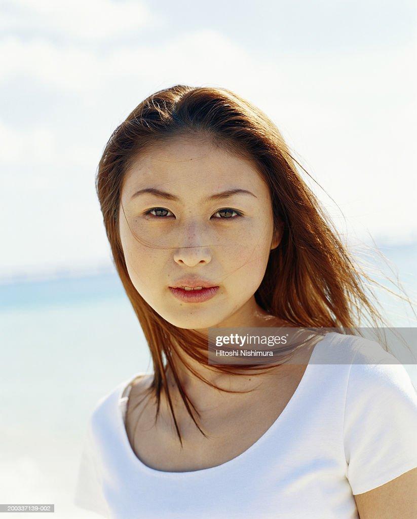 Woman on beach, close-up, portrait : Stock Photo