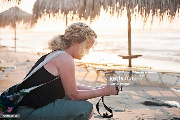 Woman on beach looking at camera