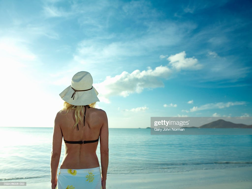 Woman on beach, rear view, close-up