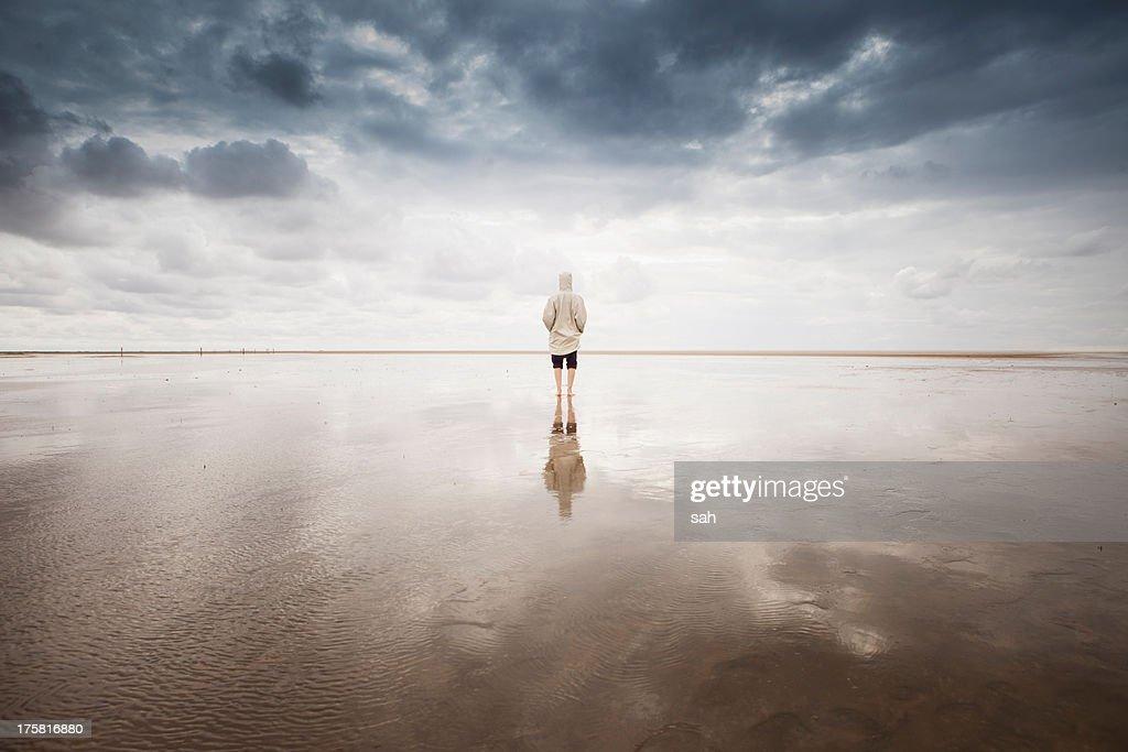 Woman on beach, Schleswig Holstein, Germany