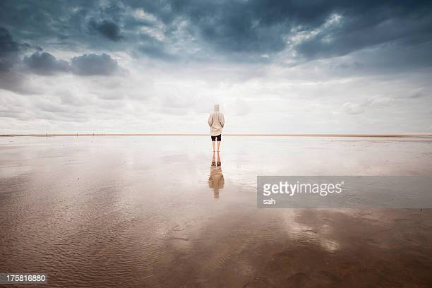 Woman on beach, Schleswig Holstein, Germany