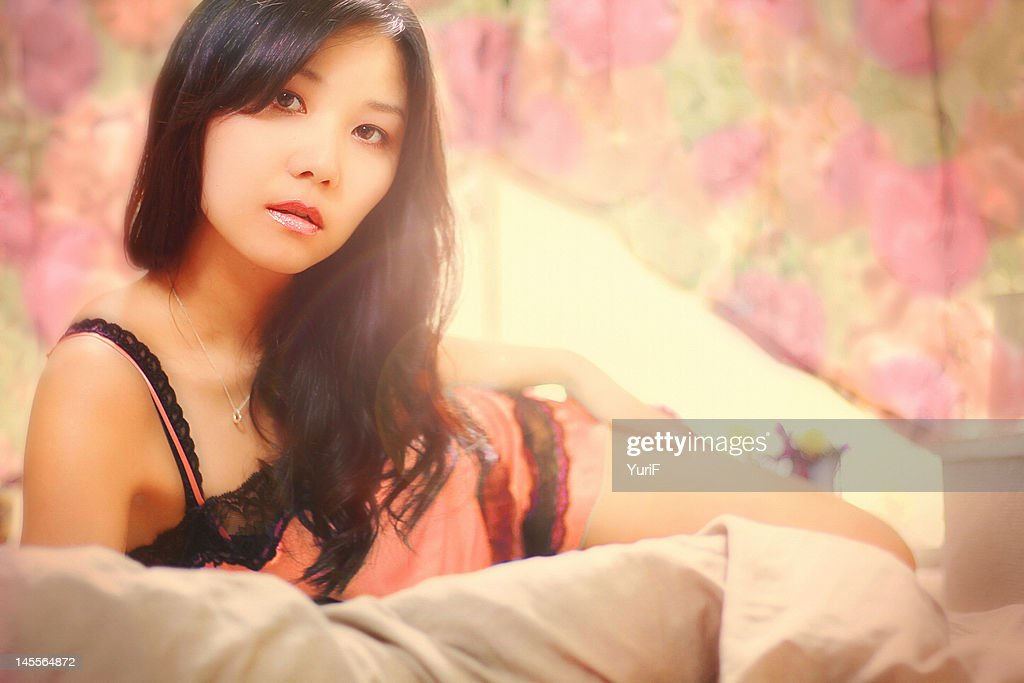 Woman on bed : Stock Photo