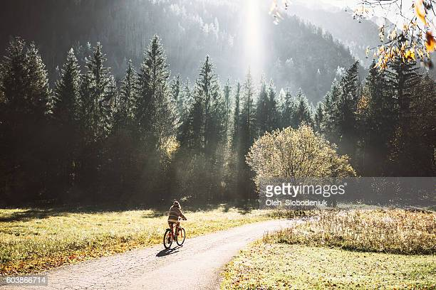 Woman on bicycle in forest