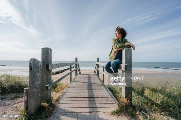 Woman on boardwalk at the beach