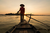 Woman on boat on Tonle Sap river, Phoum Kandal, Kompong Chnang, Cambodia