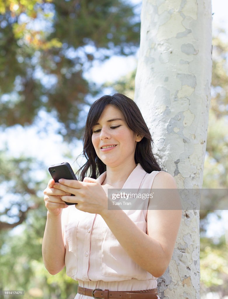Woman on cell phone, texting : Stock Photo