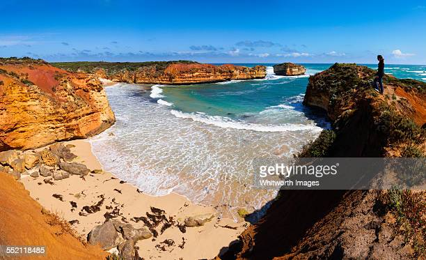 Woman on cliff above bay on Great Ocean Road