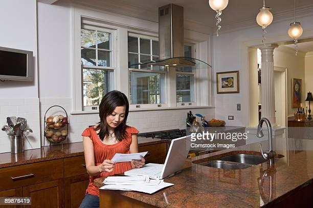 woman on computer doing bills
