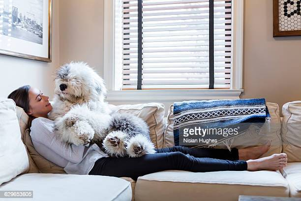 Woman on couch with her pet dog