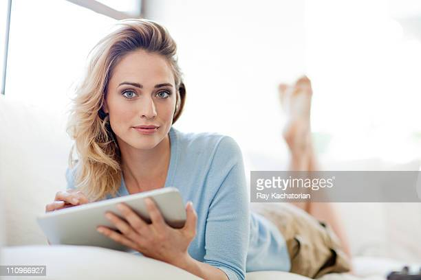 Woman on couch with Tablet
