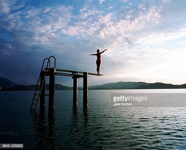 Woman on Diving Board in Lake