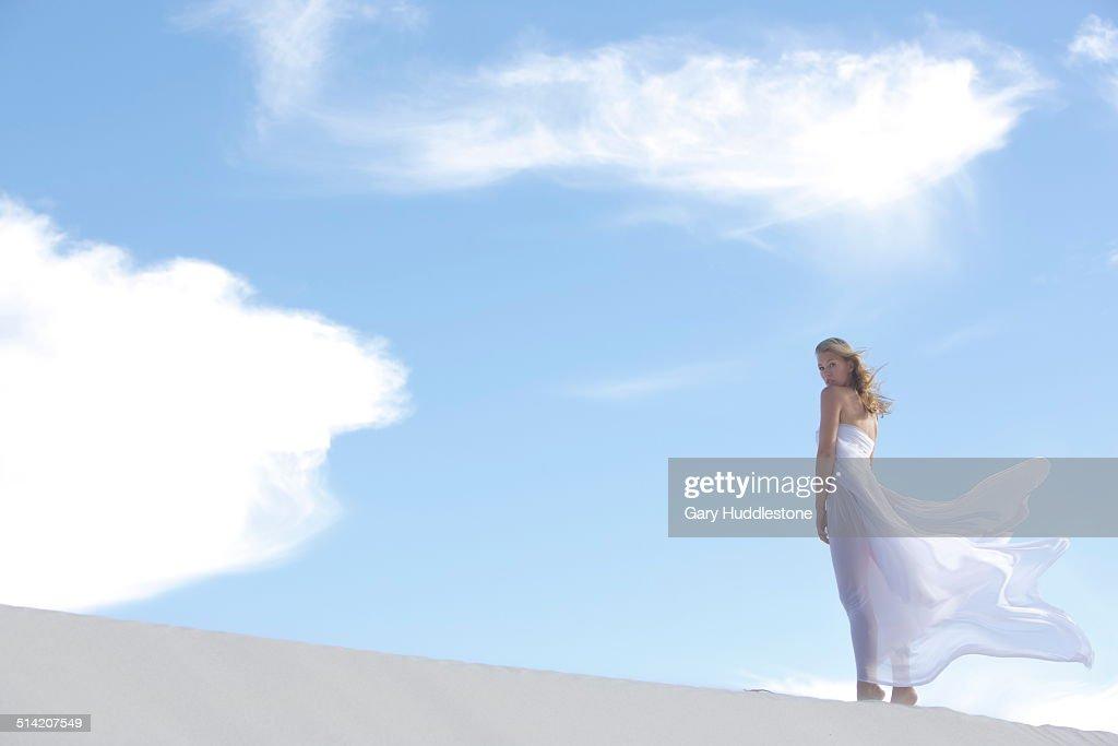 Woman on Dune in Desert