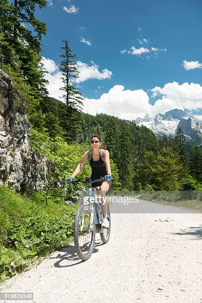 Woman on E-Bike Mountainbike in Nature, Dachstein Glacier, Austrian Alps
