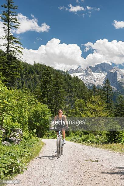 Woman on E-Bike Mountainbike in Nature, Dachstein Glacier
