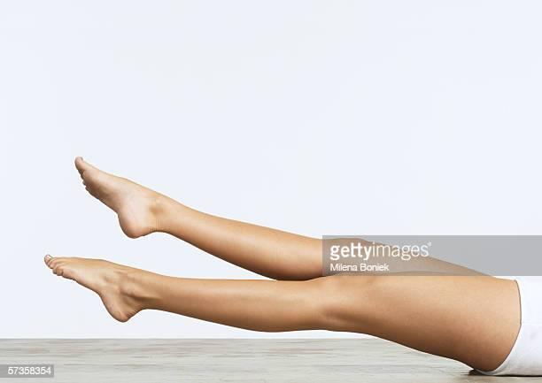 Woman on floor doing leg exercises
