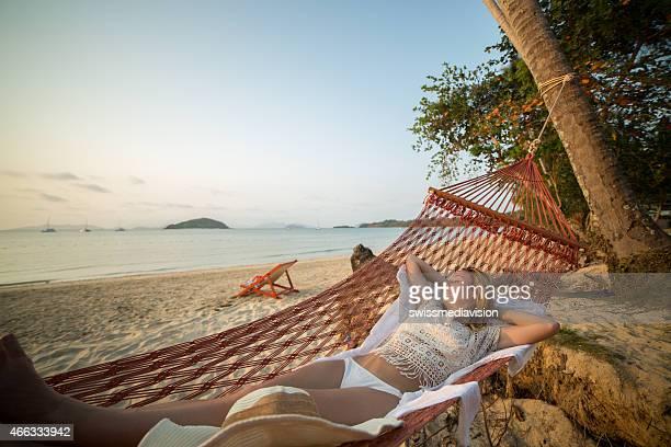 Woman on hammock at tropical beach