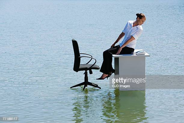 A woman on her desktop on top of water