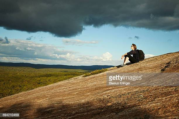 A woman on hill in countryside