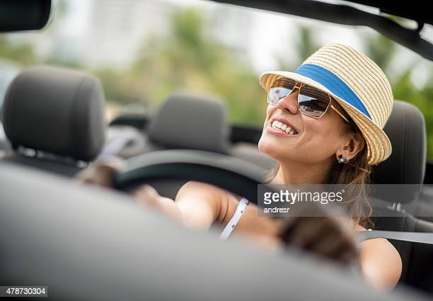 Woman on holidays driving a car
