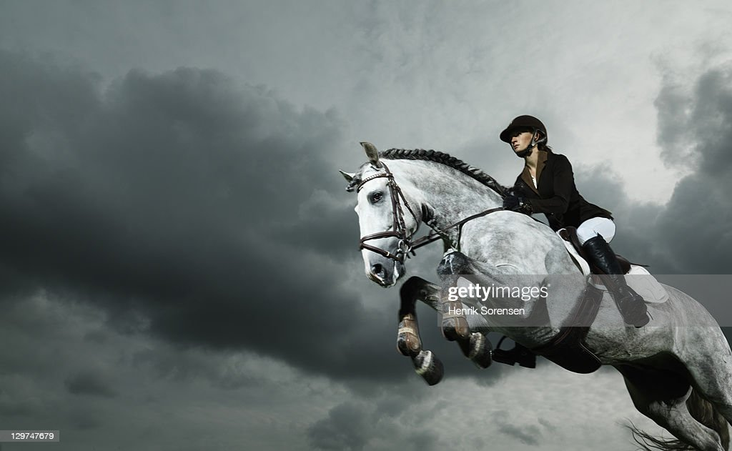 woman on horse jumping : Stock Photo