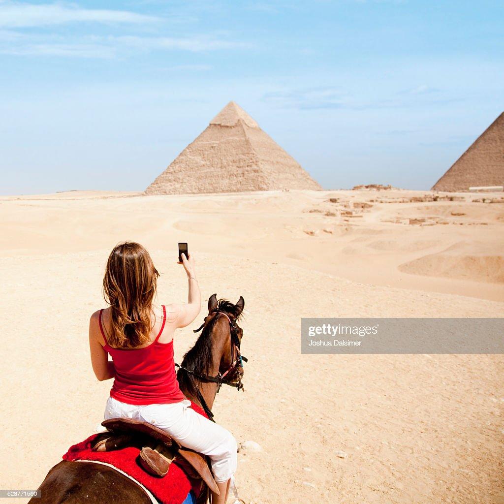 Woman on horseback in the desert : Stock Photo