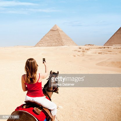 Woman on horseback in the desert : Stock Photo