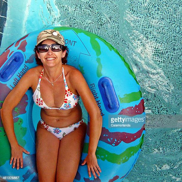 Woman on inflatable ring in pool
