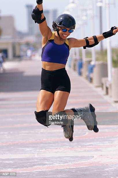 Woman on in-line skates jumping