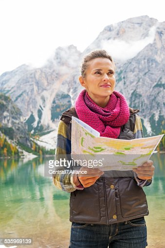 Woman on lake braies in south tyrol, italy : Stock Photo