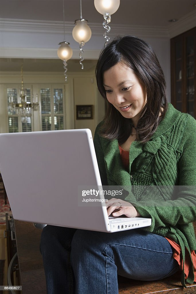 Woman on laptop computer : Stock Photo
