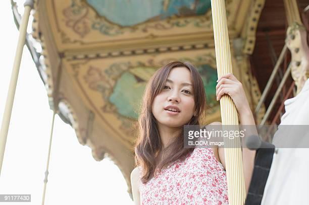 Woman on merry-go-round