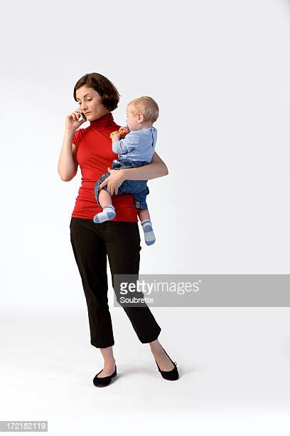 Woman on mobile phone holding baby