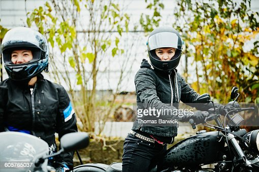 Woman on motorcycle preparing for ride