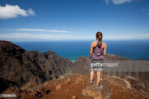 Woman on mountain top viewing ocean