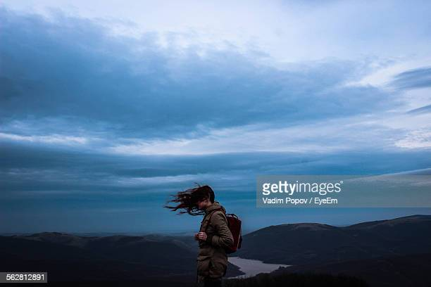 Woman On Mountain With Windswept Hair