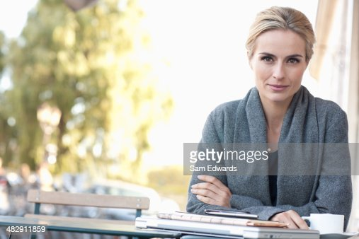 Woman on outdoor patio with coffee