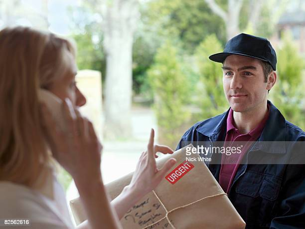 Woman on phone, courier in doorway