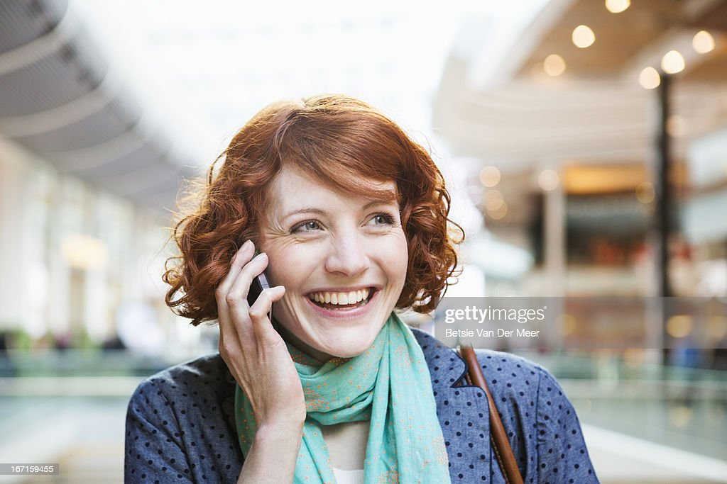 Woman on phone in urban city area.