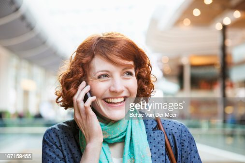 Woman on phone in urban city area. : Stock Photo